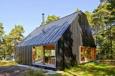 house husarö in  #sweden  by tham & videgård: the dwelling is clad entirely with folded black sheet metal, shaped in response to the plot's lighting conditions and potential sightlines towards the adjacent sea.  #architecture   http://www.designboom.com/architecture/tham-videgard-arkitekter-house-husaro-stockholm-10-10-2014/