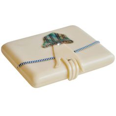An Art Deco celluloid case with a jeweled hand closure from the Roaring Twenties. A very clever design, 1920s  2 3/4 x 3 1/2 inches