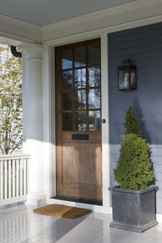 Front Door Detail Shingle Style Entryway Front Facade by Anne Decker Architects Exterior House Colors, Exterior Doors, Exterior Design, Exterior Paint, Light Blue Houses, Brown Front Doors, Blue Siding, Garage Door Styles, Garage Doors