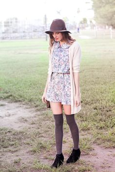 A spring look: floral dress, short-sleeve cardigan, and thigh-high socks.