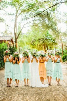 Adorable wedding dress & cute bridesmaids dresses. Love how maid of honor has a different color ☺ I will be doing that.