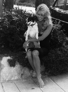 Brigitte Bardot holding her dog, Guapa, in 1959.