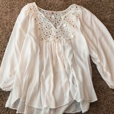 Rebecca Taylor white cut out blouse Cute mirror/cut out detail around neck and on back, flowing white blouse. Good condition. Rebecca Taylor Tops Blouses