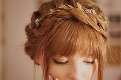 Love this! Her hair color is so beautiful. I like hairstyles that are sort of vintage and classic. The flowers really give the style a wild/flower child kind of look.