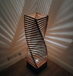 Wooden floor lamp made from a spiral of 109 interlocked wooden elements which stands around 1 meter tall and 30cm wide.  In the daytime this floor standing lamp is a beautiful sculpture but come night this large lamp transforms any room into a relaxed and atmospheric area. The beautiful and unique piece includes an integrated CE marked light fitting in the base with a 2m cable and pre-wired (U.K) wall plug.  The LUNA lamp - Two principles, one negative, dark (YIN) and one positive, bright…