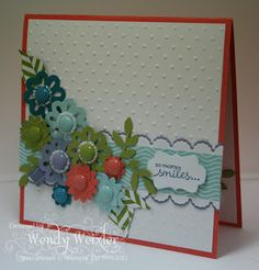 """Stamps: Petite Pairs  Paper: Calypso Coral, Lucky Limeade, Pool Party, Island Indigo, Wisteria Wonder, Whisper White, Summer Smooches DSP, Sweet Shoppe DSP  Ink: Island Indigo  Accessories: Perfect Polka Dots Textured Impressions Folder, Blossom Bouquet Punch, BoHo Blossoms Punch, 1⁄2"""" Circle Punch, Crop-a- Dile, Island Indigo Baker's Twine, Pool Party Baker's Twine, Wisteria Wonder Baker's Twine, Lucky Limeade Baker's Twine, Designer Printed Brads, Little Leaves Sizzlets Die, Build a…"""