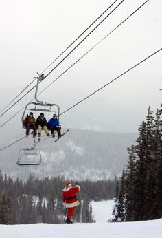 Santa taking time out of his busy schedule to greet skiers and snowboarders on the mountain today.