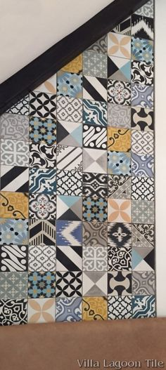 Beautiful feature wall using an assortment of our in stock cement tile by Nicole Chaves Design.