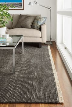 Hand knotted from 100% wool, this rug features a plush loop-and-pile pattern that feels luxurious underfoot. The ribbed effect lends subtle, modern style and fringe at the ends finishes the rug in a traditional way.