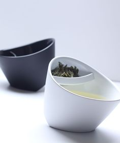 Magisso Tipping Teacup - White | dotandbo.com // This would be awesome in the office or at school, only downside is - it's plastic.  But still an easy way to brew one cup of loose tea w/out a teapot.