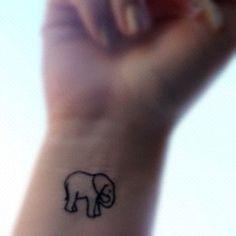 Simple elephant tattoo on wrist....hmmm I would love a small tiger like this.