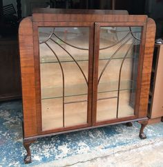 Top corners are rounded. Wood trim on the door fronts are in the attractive sunburst style. Has 2 glass display shelves inside, glass sides, lovely little carved detail on the corners. | eBay!