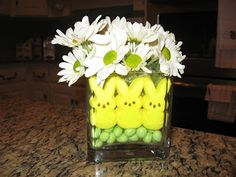 You can use White Gerberas for this centerpiece