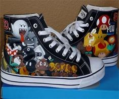 Super Mario Sneakers  Power up your collection of footwear with these hand painted Super Mario high top sneakers that feature all the classics from the Super Mario series – from goombas to pirahna plants to power stars to Bowser himself – these will be the most nostalgic shoes you'll ever own.