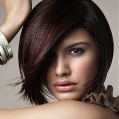 Cute cut with burgundy highlights on dark brown hair