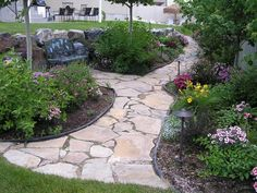 Love this style of walkway. Darker stone would be better.