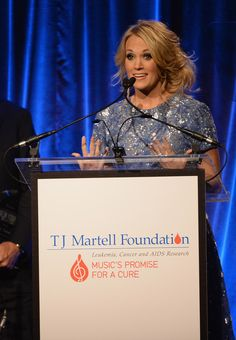 Carrie Underwood accepts the Artist Achievement Award at the T.J. Martell Foundation's 38th Annual Honors Gala on October 22, 2013.