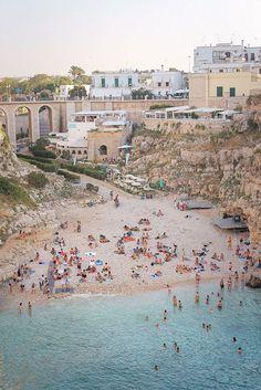 A popular Italian beach in Polignano a Mare, Puglia, Italy