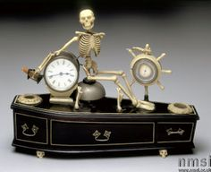 Victorian skeleton automaton alarm clock; the clock is a symbol of the passing of time, while the skeleton and coffin remind us that death awaits us all at the end of 'our time'.