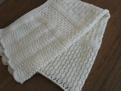 http://www.ravelry.com/patterns/library/b14-22-blanket-with-lacy-pattern-in-alpaca