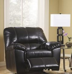 """Fort Logan Rocker Recliner- Signature Design By Ashley  With a divided back for added lumbar support and optional power recline, this furniture collection adds a deep comfort perfect for any living environment. Make a statement with the comfortable contemporary style of the """"DuraBlend®-Black"""" upholstery collection."""