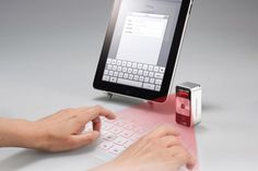 Item of the Moment: Magic Cube. This amazing device connects wirelessly to your iPhone, iPad, or Android and projects a full-size laser keyboard image that you can type on. Latest Gadgets, Gadgets And Gizmos, Tech Gadgets, Cool Gadgets, Amazing Gadgets, Office Gadgets, Cubes, Handwriting Recognition, Bluetooth