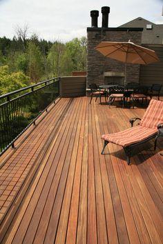 Beautiful Cumaru Hardwood Deck on a Second Floor Balcony. 1x4 E4E Cumaru, Brazilian Teak Hardwood from Nova USA Wood.