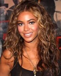 beyonce knowles long dark curly hairstyle with blonde highlights