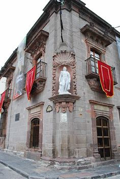 Corner of Allende House with statue of Ignacio Allende, in San Miguel de Allende, Guanajuato, Mexico:  Ignacio Allende y Unzaga, was a captain of the Spanish Army in Mexico who came to sympathize with the Mexican independence movement. He fought alongside the rebels, and when Spanish authorities captured him, he was executed for treason. by AlejandroLinaresGarcia