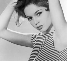 Parisian Chic: French actress Brigitte Bardot wearing a black and white striped top.