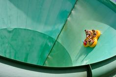 """Photos: A January Heat Wave in Australia - The Atlantic. People ride on a water slide named """"Green Room"""" at WhiteWater World in Gold Coast, Australia, on December Gold Coast Australia, South Australia, Whitewater World, World Water, Pretty Beach, Weird Creatures, Water Slides, Byron Bay, Nature Reserve"""