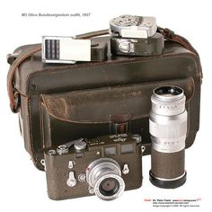 Leica M3 Olive Bundeseigentum camera/lens/accessories outfit. An early, green painted Leica M3, by Leitz company restored condition with Bundeseigentum engravings, the companion lenses used is a Leitz Elmar 2.8/5cm, Hektor 4.5/13.5cm which came with a mat