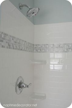 wall paint: Sherwin Williams Rainwashed white vinyl beadboard on the bottom white subway tile with an accent strip of marble and 2 small corner shelves - DIY Home Decor Shower Accent Tile, White Subway Tile Bathroom, Subway Tile Showers, Gray And White Bathroom, Shower Tiles, Childrens Bathroom, Small Bathroom, Bathroom Ideas, Vinyl Beadboard