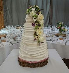 Ruffle Wedding Cake, fresh flowers. Beautiful Wedding Cakes made to order in Swansea and South Wales. Custom made design to your specific needs. Looking elegant and tasting delicious. Please contact me with any questions or to arrange a consultation.