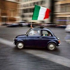 Fiat 500. The flag is almost bigger than the car