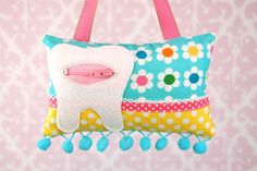 Tooth Fairy Pillow- In Remix Fabric by Ann Kelle for Robert Kaufman, Blue Pink Yellow Daisies. $15.00, via Etsy.