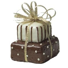 Gifts That Glitter Mini Cakes - Add a little glitz to your holiday gathering with Gifts That Glitter Mini Cakes. Cut a sheet cake with our Square Cut-Outs and cover each with Candy Melts. With a few candy details and a sparkling gold ribbon, it's a treat that is sure to dazzle.