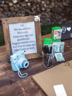 Place a Polaroid camera with film on a rustic table for an alternative approach to the wedding guest book. Guests can leave the newlyweds with some sweet selfies.
