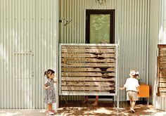 """An outdoor shower tucked behind a screen off the master bedroom neutralizes this threat. """"We thought it sounded great for muddy kids to run up and shower off there,"""" Coco says."""