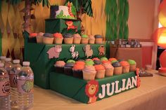 My son's first birthday party had a fun jungle theme. Awesome homemade cupcake and smash cake stand, personalized water bottle labels, yellow and green streamers. Jungle Cupcakes, Jungle Theme Cakes, Jungle Theme Parties, Jungle Theme Birthday, Party Themes, Party Ideas, First Birthday Activities, First Birthday Parties, First Birthdays