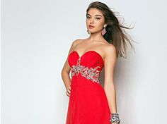 I got: Red! What Color Should Your Prom Dress Be?You'll stand out from the crowd in your sassy, red dress.