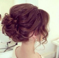 Cute up do to go with the illusion neckline