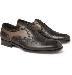 Bottega Veneta's two-tone leather brogues are a refreshing reinvention of a classic shoe. Finished by hand, with visible taupe stitching, this panelled pair will make a luxurious addition to your professional portfolio. Wear them with a slim-fit shirt and pressed trousers for an accomplished formal look.
