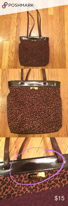 """Small Leopard Print Purse by Nine West Super cute Nine West leopard print bag. Unsure of the material. Only used once or twice and in pretty good condition. Has some marks that aren't very noticeable imo. It was hard to get a photo of the marks but they're circled in the 3rd image. Inside is a little dirty but not too bad. Size is approx. 9.5""""x10"""", strap length is approx 14"""". Feel free to ask any further questions or make an offer via the offer button below 👇 Nine West Bags Shoulder Bags"""