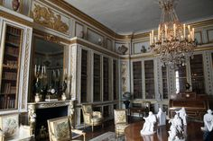 The subdued library of the Chateau de Versailles.