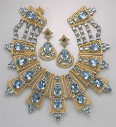 William DeLillo Egyptian-inspired collar and earrings, with simulated aquamarines in gilt metal,  circa 1960s-70