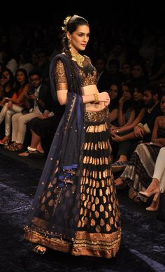 Black brocade cowled lehenga with a midnight blue dupatta.