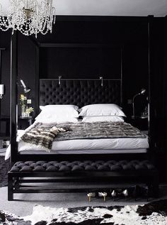Love this black chesterfield bed with chandelier