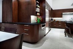 Decoration: Wooden Decor Open Kitchen And Living Area With Surrounding Built In Wooden Cabinet Also White Ceramics Floor Tiles Design Ideas: Dissolving Restrictions : Residence Surrounded by Trees in Austin, Texas