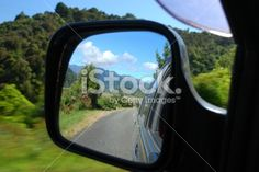 Looking Back in a Car Wing Mirror Royalty Free Stock Photo